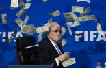 (VIDEO): British Comedian Lee Nelson Throws Money At Sepp Blatter