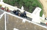 Police arrest shirtless man on roof of Melbourne's Government House